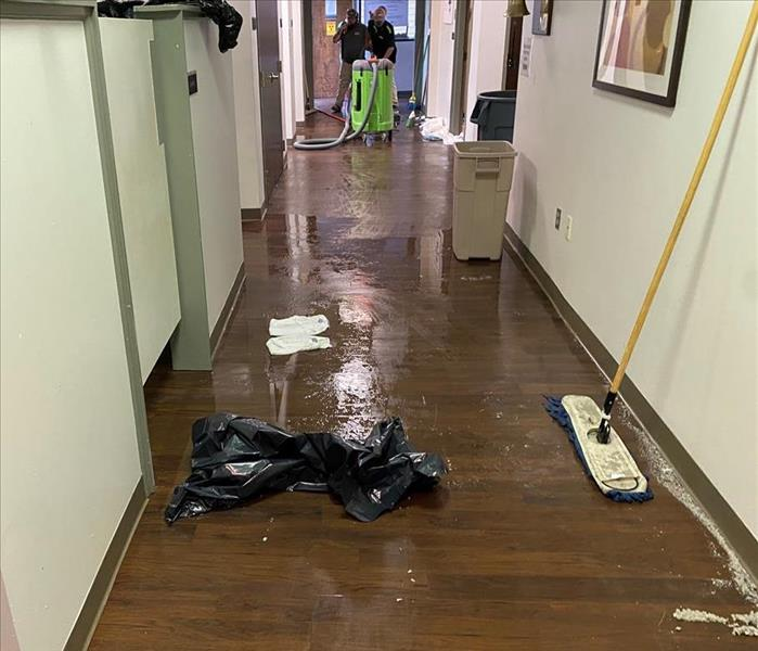 Commercial Hallway with standing water damage