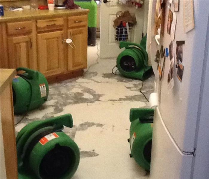 residential concrete floor with four large air movers