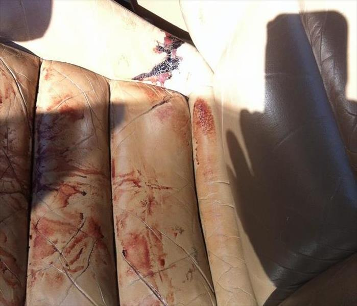 leather car seat with blood on it