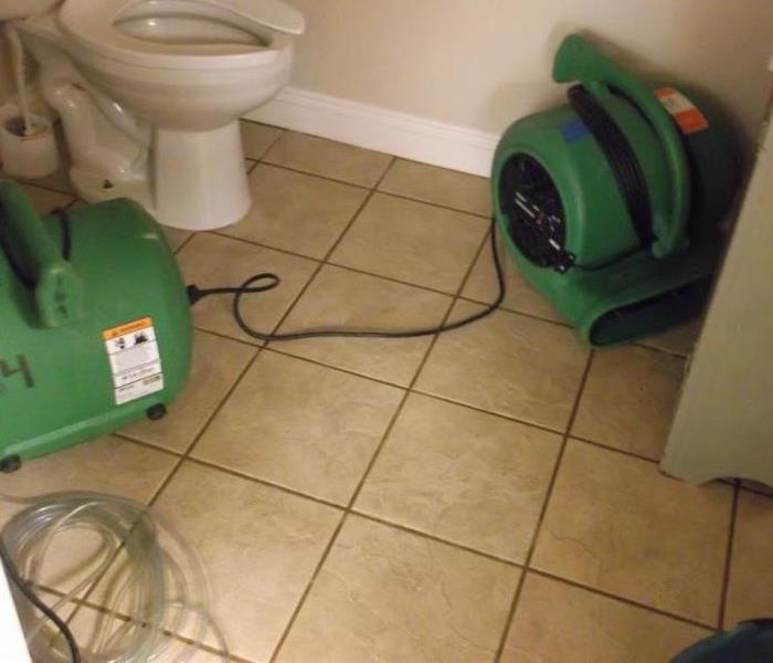 cleaned tile on bathroom floor with green SERVPRO fans