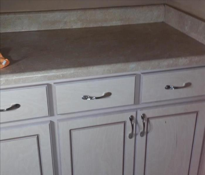 white kitchen cabinets with beige countertops