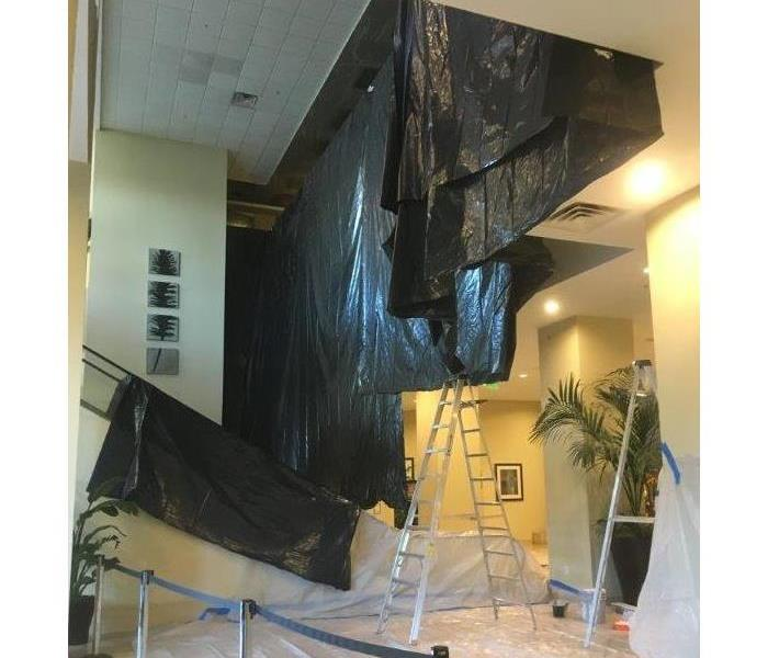 Building with tarps in interior room