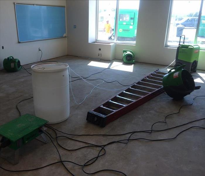 dry flooring in classroom with ladder and cords