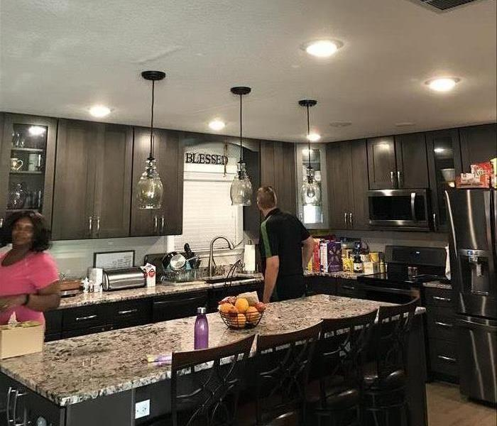 Repaired Kitchen with Black Appliances