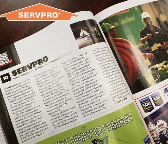 Magazine Article featuring SERVPRO on Wooden table