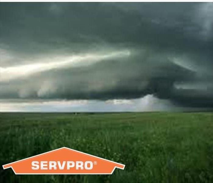 Storm Clouds over a field with SERVPRO logo